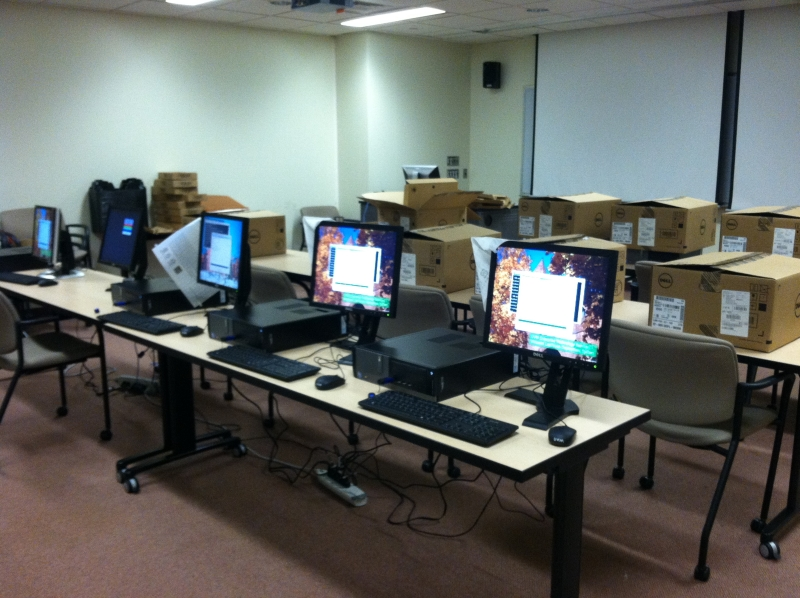 Setting up the new computers to be installed in classrooms.